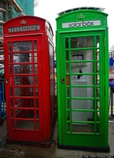The first traditional London telephone box (R) to be transformed into a solar-powered mobile phone charger for use by the public, is pictured next to a traditional red telephone box in central London, on October 1, 2014. Use of the facility is expected to be free of charge. AFP PHOTO/CARL COURT (Photo credit should read CARL COURT/AFP/Getty Images)